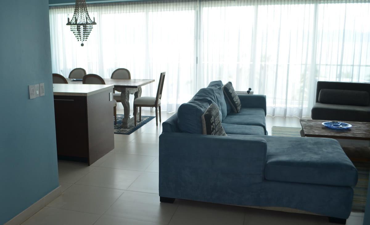 Kitchen and living room Icon Vallarta Beachfront Condo For Rent