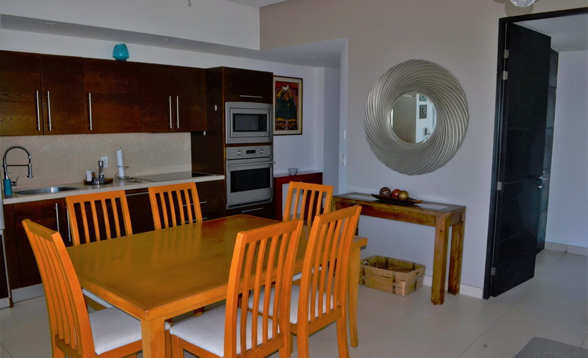 Dining room and kitchen Icon Vallarta Condo Rental
