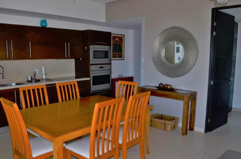 Dining room and kitchen Icon Vallarta Condo Rental