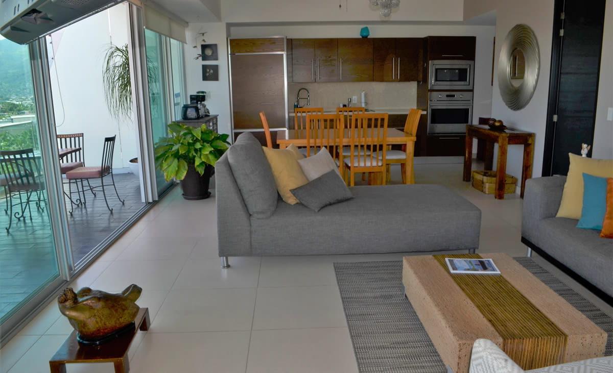 Living room and kitchen Icon Vallarta Condo Rental