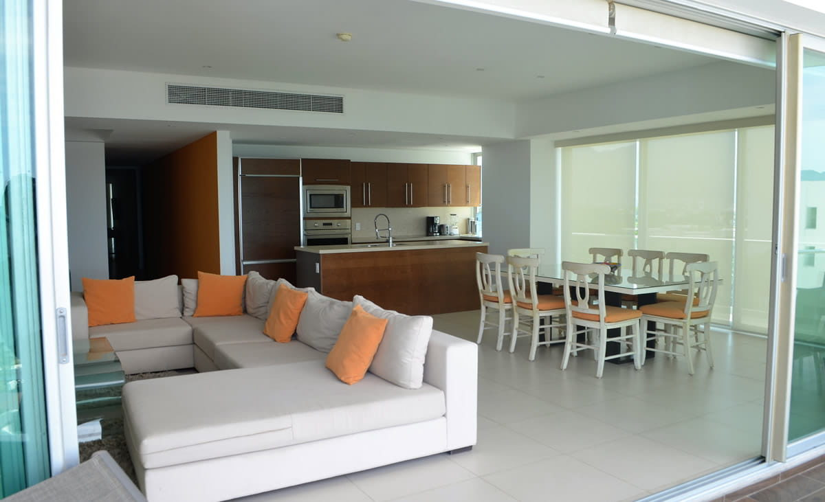 Living room and dining room Icon Vallarta Luxury Condo Rentals