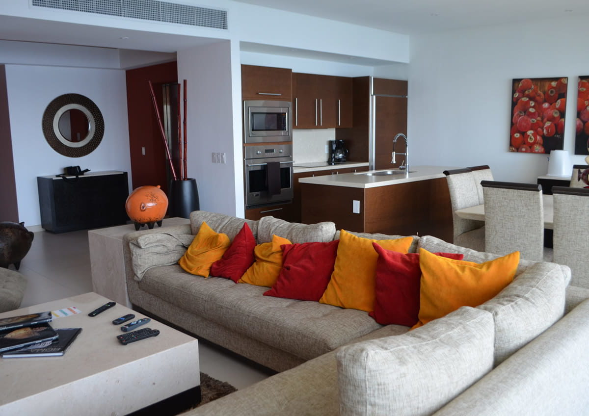 Living room and kitchen Icon Vallarta Condo Rentals